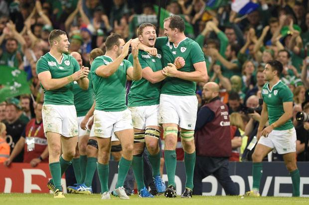 Ireland's lock Iain Henderson celebrates with team-mates after winning the Pool D match of the 2015 Rugby World Cup between France and Ireland at the Millennium Stadium in Cardiff
