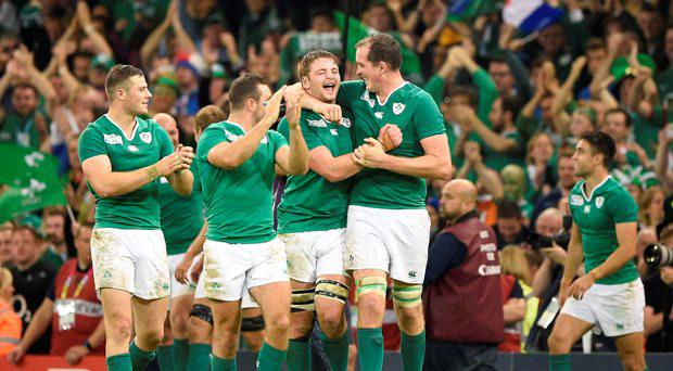 Ireland's lock Iain Henderson (C) celebrates with team-mates after winning the Pool D match of the 2015 Rugby World Cup between France and Ireland at the Millennium Stadium in Cardiff, south Wales, on October 11, 2015