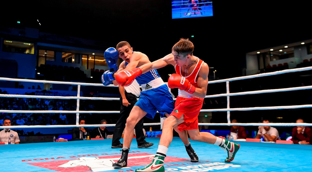 Michael Conlan, right, goes on the attack during his bantamweight semi-final against against Dzmitry Asanau from Belarus in Doha.