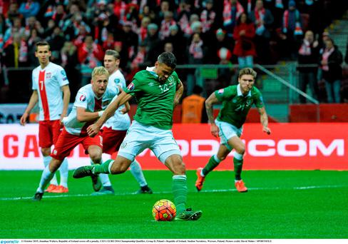 Jonathan Walters scores from the penalty spot during the 2-1 defeat to Poland in Warsaw.