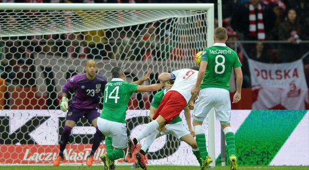 Poland's Robert Lewandowski scores their second goal