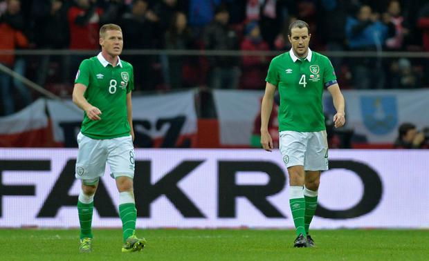 Football - Poland v Republic of Ireland - UEFA Euro 2016 Qualifying Group D - Stadion Narodowy, Warsaw, Poland - 11/10/15 Ireland's John O'Shea and James McCarthy look dejected after Poland's Robert Lewandowski (not pictured) scores their second goal Action Images via Reuters / Adam Holt Livepic EDITORIAL USE ONLY.