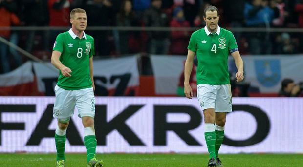 Ireland's John O'Shea and James McCarthy look dejected after Poland's Robert Lewandowski (not pictured) scores their second goal