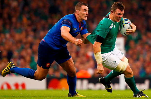 Peter O'Mahony has his shirt pulled by Louis Picamoles of France in Cardiff last month
