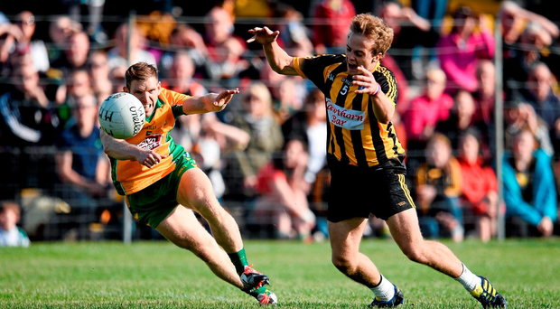 Mountbellew-Moylough's Colm Mannion, right, in action against Corofin's Ciaran McGrath in the Galway County Senior Football Championship Final yesterday