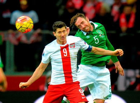Republic of Ireland's Richard Keogh challenges Poland's Robert Lewandowski