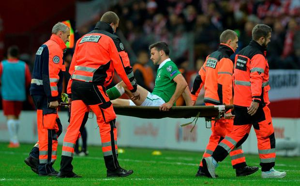 Shane Long is stretchered off after sustaining an injury
