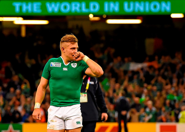 An emotional Ian Madigan salutes the fans after victory over France in Cardiff yesterday