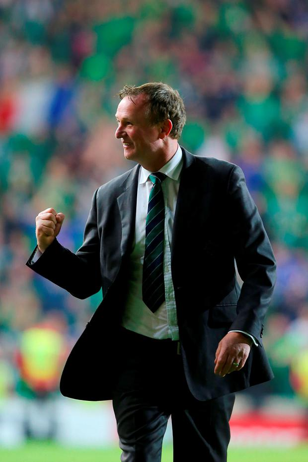 Michael O'Neill celebrates after the final whistle