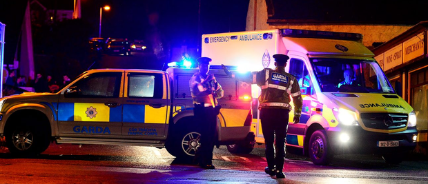 An ambulance leaves the scene in Omeath where Garda Tony Golden was shot dead after he was called to a domestic dispute