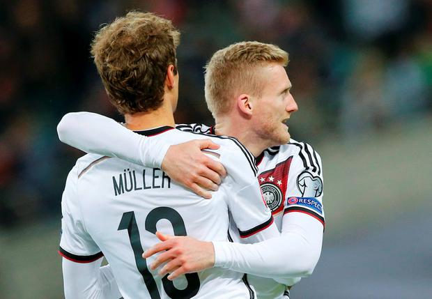 Germany's Thomas Mueller celebrates his goal against Georgia Andre Schuerrle