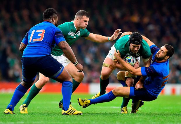 Sean O'Brien is tackled by France's Remi Tales as Robbie Henshaw (left) rushes to his assistance, closely shadowed by Mathieu Bastareaud