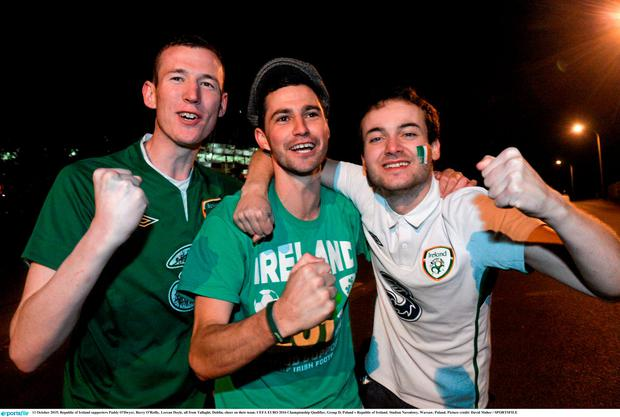 Republic of Ireland supporters Paddy O'Dwyer, Barry O'Reilly, Lorcan Doyle, all from Tallaght, Dublin, cheer on their team. UEFA EURO 2016 Championship Qualifier, Group D, Poland v Republic of Ireland. Stadion Narodowy, Warsaw, Poland