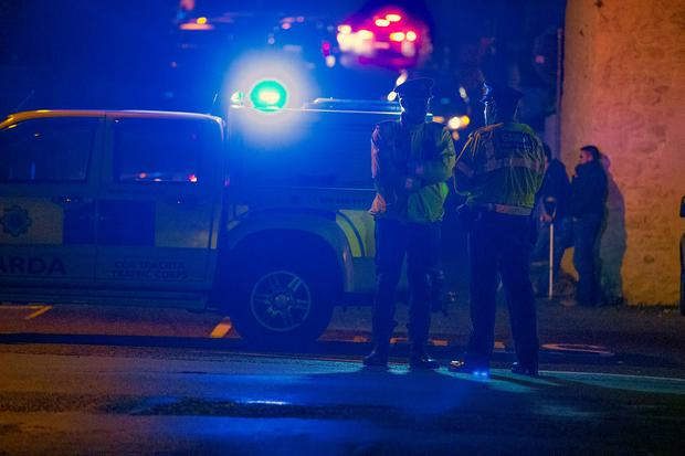 Gardai investigate a shooting in Omeath, Co Louth where two people including a Garda where shot dead. Picture:Arthur Carron