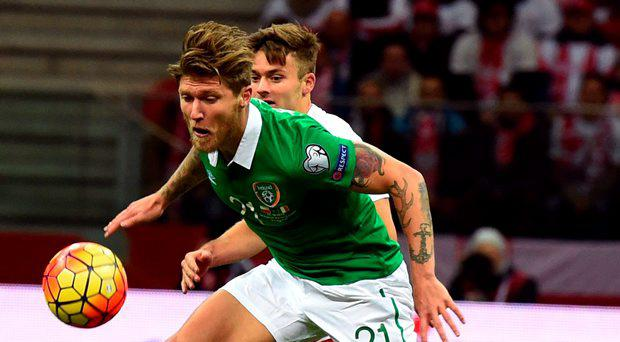 Jeff Hendrick (L) of Ireland and Karol Linetty of Poland vie for the ball during the Euro 2016 Group D qualifying football match between Poland and the Republic of Ireland at the Stadion Narodowy in Warsaw on October 11, 2015