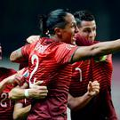 Portugal's defender Cedric Soares (L), defender Bruno Alves (C) and forward Cristiano Ronaldo (R) celebrate midfielder Joao Moutinho's goal during the Euro 2016 qualifying
