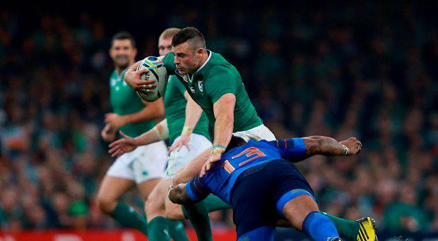 Ireland's Robbie Henshaw gets past France's Mathieu Bastareaud (right) during the Rugby World Cup match at Millennium Stadium