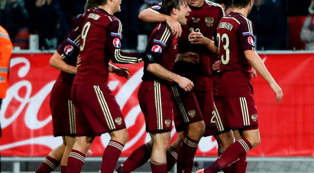 Oleg Kuzmin (centre) put the Russians ahead with his first international goal on 33 minutes and Alexander Kokorin added the second from the penalty spot four minutes later to ensure that his side finished ahead of Sweden
