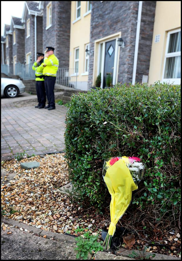 Flowers are left at the scene of the shooting of Garda Tony Golden in Omeath