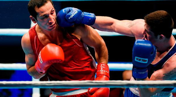 Joe Ward connects with a right on his way to beating Uzbekistan's Elshod Rasulov in the semi-final