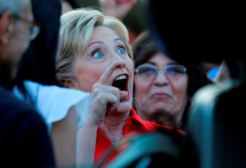 Democratic U.S. presidential candidate and former Secretary of State Hillary Clinton greets members of the culinary workers union local 226 as she arrives to speak at a demonstration outside the Trump Hotel in Las Vegas, Nevada