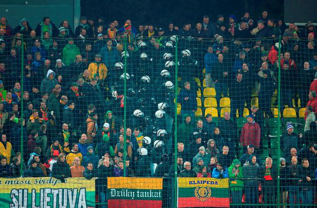 Riot Police separate Lithuania and England fans in the stands during the UEFA European Championship Qualifying match at the LFF Stadium, Vilnius last night