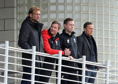 New Liverpool Manager Jurgen Klopp (left) with Academy Director Alex Inglethorpe, U21 coach Michael Beale and First-Team Development Coach Pepijn Lijnders during the Liverpool v Stoke City U18 Premier League game at the Liverpool FC Academy