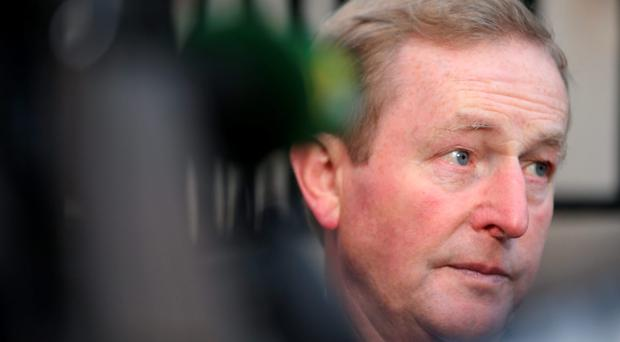 Taoiseach Enda Kenny arrives at Government Buildings this morning. Photo: Gerry Mooney