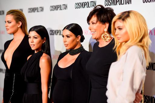 (L-R) TV personalities Khloe Kardashian, Kourtney Kardashian, Kim Kardashian, Kris Jenner and Kylie Jenner in West Hollywood, California. (Photo by Frazer Harrison/Getty Images for Cosmopolitan)