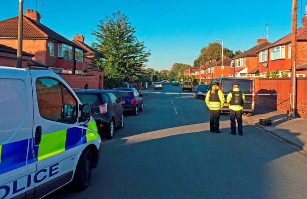Police at Gillingham Street, Salford where a youngster and his mother suffered leg wounds in the doorway of their home last night after being caught in crossfire. Pat Hurst/PA Wire