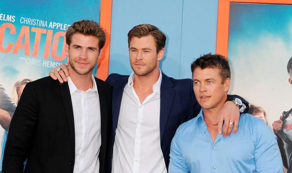(L-R) Actor/brothers Chris Hemsworth; Liam Hemsworth; Luke Hemsworth arrives at the Premiere Of Warner Bros. 'Vacation' at Regency Village Theatre on July 27, 2015 in Westwood, California.(Photo by Jeffrey Mayer/WireImage)