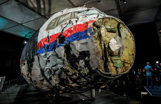 The reconstructed wreckage of the MH17 airplane is seen after the presentation of the final report into the crash of July 2014 of Malaysia Airlines flight MH17 over Ukraine REUTERS/Michael Kooren