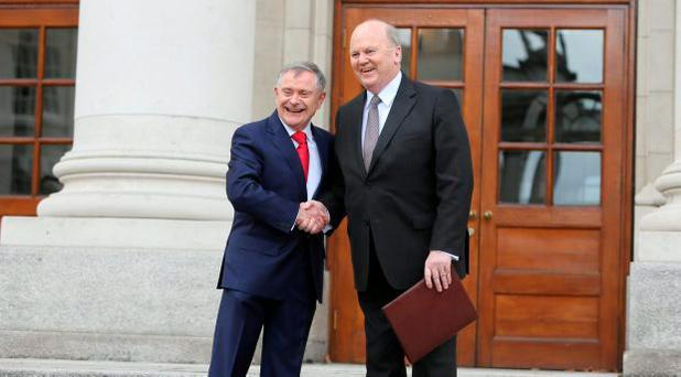 Minister for Public Expenditure Brendan Howlin and Finance Minister Michael Noonan pose with Budget 2016 outside the Dail. Photo: Gerry Mooney