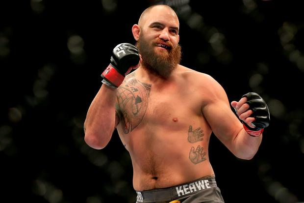 Travis Browne reacts against Brendan Schaub in their fight during the UFC 181 event at the Mandalay Bay Events Center on December 6, 2014 in Las Vegas, Nevada. (Photo by Alex Trautwig/Getty Images)