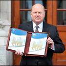 Minister for Finance Michael Noonan TD delivers the Budget on the steps of Government Buildings. Pic Steve Humphreys 13th Ocober 2015.
