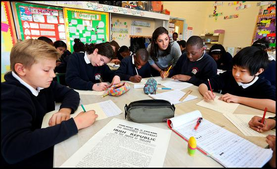 Students from St John The Evangelist National School in Adamstown, Dublin working on a new Proclamation based on the 1916 Proclamation. From left: Jakub Robertson, Aoife O'Driscoll, Gozie Chukwudi, teacher Aoife Rice, Ayo Fatola and Cahill Wan. Photo: Steve Humphreys