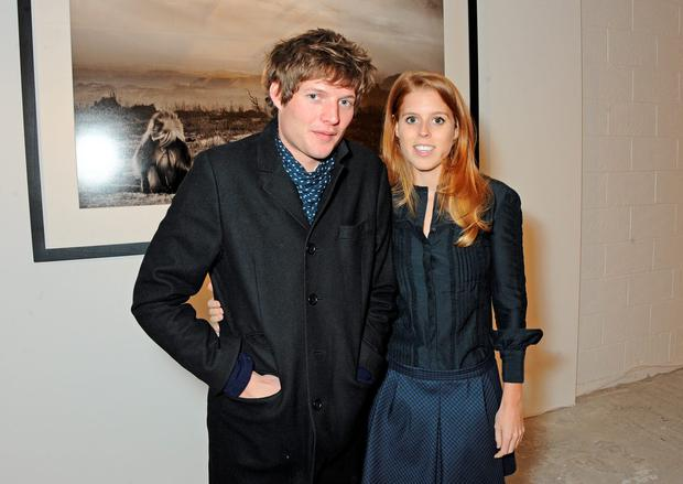 Nikolai Von Bismarck (L) and Princess Beatrice of York attend a private view of Nikolai Von Bismarck's new photography exhibition 'In Ethiopia' at 12 Francis Street Gallery on December 3, 2013 in London, England. (Photo by David M. Benett/Getty Images)