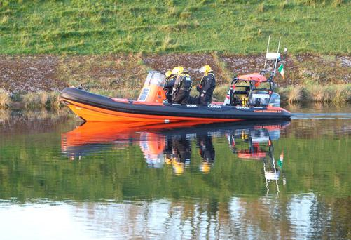 Members of the Irish Coast Guard search along the canal banks near Ardnacrusha power station after a walker claimed to have seen a body in the water. Photograph Liam Burke/Press 22