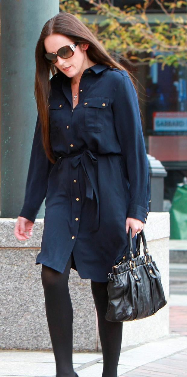 Lorraine Drumm, David Drumm's wife, arrives at the federal courthouse in Boston, Oct. 13, 2015 before the Drumm's extradition hearing