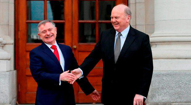 Minister for Public Expenditure and Reform Brendan Howlin (left) and Minister for Finance Michael Noonan deliver the 2015 Budget at Government Buildings, Dublin