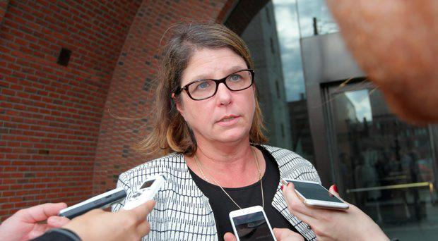 Tracy Miner, David Drumm's attorney, speaks to reporters in front of the federal courthouse in Boston, Oct. 13, 2015 after Drumm's extradition hearing
