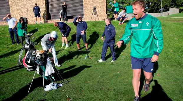 Luke Fitzgerald takes a wild swing... to the amusement of his rugby pals