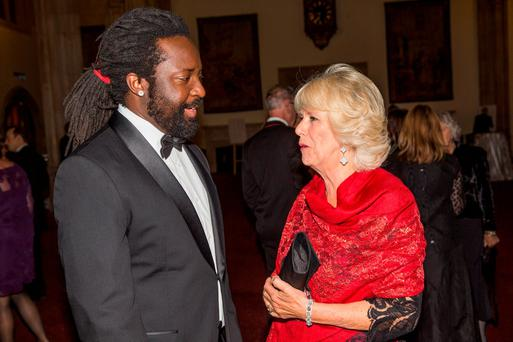Britain's Camilla, Duchess of Cornwall speaks with nominated author Marlon James (L) at the ceremony for the Man Booker Prize for Fiction 2015 in London, Britain October 13, 2015