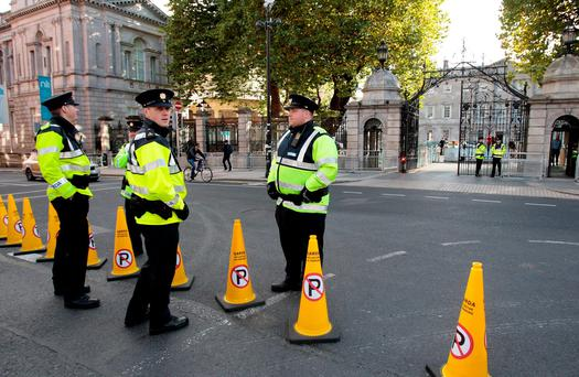 Gardaí on duty at Leinster House yesterday. Photo: Tom Burke
