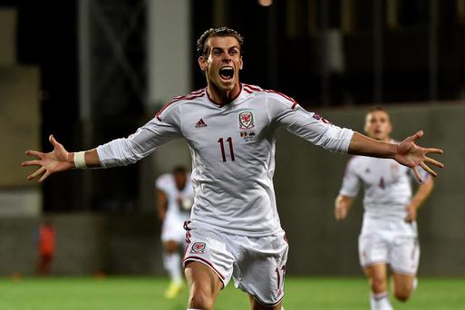 Wales forward Gareth Bale celebrates after scoring a goal during the Euro 2016 qualifying round match with Andorra (PASCAL PAVANI/AFP/Getty Images)