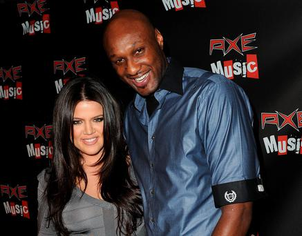 Television personality Khloe Kardashian (L) and Los Angeles Laker Lamar Odom in 2010