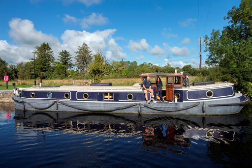 Jill Parkinson and Giles Byford on their houseboat Hawthorne on the Shannon at Carnadoe Quay, Co. Roscommon. Photo: Tony Gavin 16/9/2015