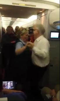 Aer Lingus air hostess Orla O'Brien dances with a passenger Credit: Facebook/Orla O'Brien