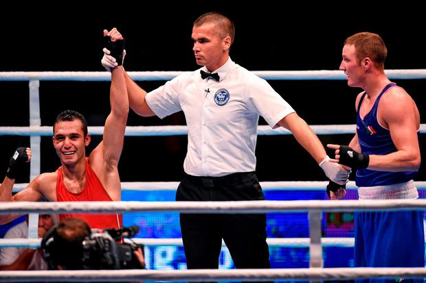 Michael O'Reilly reacts alongside coaches Zaur Antia and Billy Walsh, right, after being beaten by Hosam Abdin, Egypt, in their Men's Middleweight 75kg Box-Off bout. Picture credit: Paul Mohan / SPORTSFILE