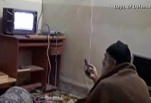 Osama bin Laden watching television at his compound in Abbottabad. Photo: Getty Images